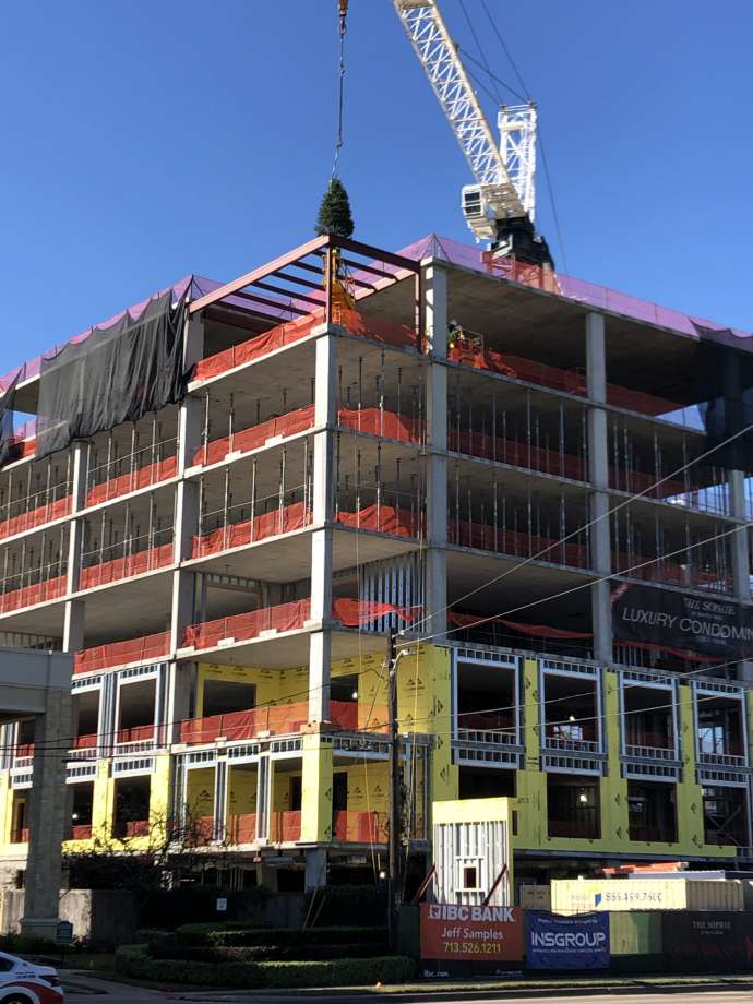 stolz tops out condo